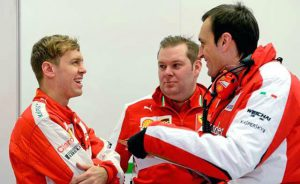 Vettel and some Scuderia Ferrari team members